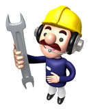 Construction site man holding a spanner Royalty Free Stock Image
