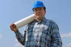 Construction site manager with building plans Stock Photography