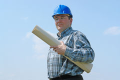 Construction site manager with building plans Royalty Free Stock Photo