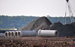 Construction Site Material. Construction site showing pipes,gravel and other equipment and material stock image