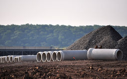 Construction Site Material. Construction site showing pipes,gravel and other equipment and material Royalty Free Stock Images