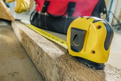 Construction Measuring Tape. Construction Site Measuring Tape Closeup Photo royalty free stock image