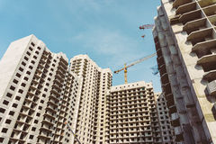 Construction site of modern concrete high-rise buildings in Voronezh city. With cranes, urban cityscape, development concept Stock Images
