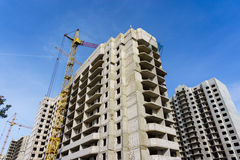 Construction site of modern concrete high-rise buildings in Voronezh city. With cranes, urban cityscape, development concept Royalty Free Stock Photo