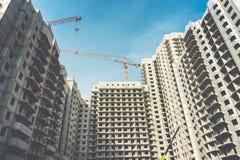 Construction site of modern concrete high-rise buildings in Voronezh city. With cranes, urban cityscape, development concept Stock Photos