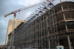 Construction site of a modern office, bank and commercial building. With equipment and supports royalty free stock photography