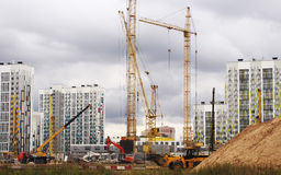 A construction site in Moscow, a lot of cranes and a concrete cut from the blue sky Stock Images