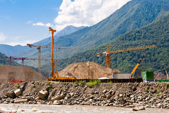 Construction site in the mountains. Construction site with construction equipment in the Caucasus Mountains. Sochi Royalty Free Stock Image