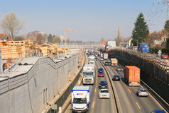 Construction Site and Moving Traffic in Hamburg. Hamburg, Germany - Februar 15, 2017: Construction site on the German freeway A7 in Hamburg seen from a bridge Stock Photo