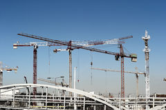 Construction site. With multiple cranes Stock Photos