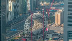 Construction site of the Museum of the Future aerial timelapse, next iconic building of Dubai. Construction site of the Museum of the Future with cranes aerial stock video
