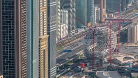 Construction site of the Museum of the Future aerial timelapse, next iconic building of Dubai. Construction site of the Museum of the Future with cranes aerial stock footage