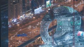 Construction site of the museum of the future aerial night view, next iconic building of Dubai. stock video footage