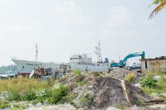 Construction site near the harbor at the tropical island Maamigili. In Maldives royalty free stock image