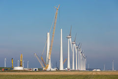 Construction site of new big Dutch wind farm in agricultural landscape Stock Photography