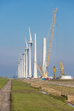 Construction site of new big Dutch wind farm in agricultural landscape Stock Photo