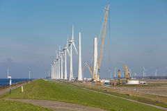 Construction site of new big Dutch wind farm in agricultural landscape Stock Photos
