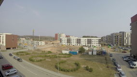 Construction site and new build home in urban place. 4K. UHD timelapse video clip stock footage