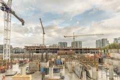 Construction site of a new house with concrete piles and reinfor stock image