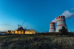 Construction site of new nuclear power plant at night.  stock image