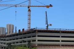 Construction site with crane. Construction site of a new parking lot Royalty Free Stock Photography