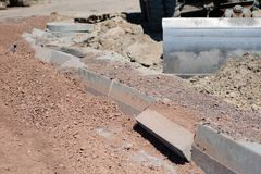 Construction site for a new road for cars. Laying paving blocks, Royalty Free Stock Photography