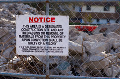 Construction site no trespassing sign. With details on felony conviction Royalty Free Stock Photography