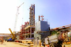Construction site for the construction of an oil refinery, the installation of rectification columns, heat exchangers, pipelines stock photo