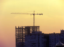 Construction site - old and new. Silhouette of the construction site at sunset Royalty Free Stock Images