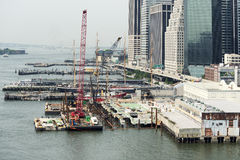 Construction site and pier on Hudson river in New York City. Royalty Free Stock Photo