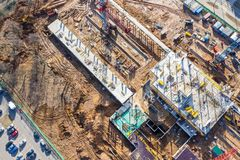 Construction site in progress. busy building site with construction machinery. aerial photo royalty free stock photography