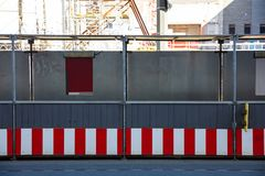 Construction site. Protective corridor for pedestrians along the street. Construction site. Protective corridor for pedestrians along the street, front view stock image