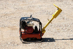 Construction site with the rammer. Construction site with the red rammer Royalty Free Stock Photo