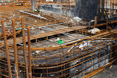 Construction Site Rebar. A large building construction site with oxidised and  rusted steel rebar frameworks for reinforced concrete Royalty Free Stock Image