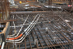 Construction Site Rebar. A large building construction site with oxidised and rusted steel rebar frameworks for reinforced concrete Royalty Free Stock Photos