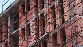 Construction Site, Residential Building and Scaffolding stock footage