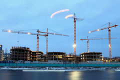 Construction site of  residential building, tower cranes with ev Royalty Free Stock Image