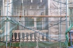 Construction site restoration work on the renovation of the old facade of the building stock image