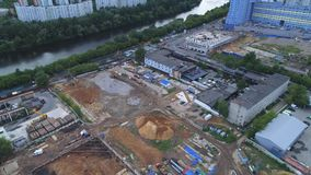 Construction site on the river bank, top view. The camera gradually decreases stock video footage