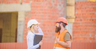 Construction site safety inspection. Discuss progress project. Construction project inspecting. Safety inspector concept stock photo