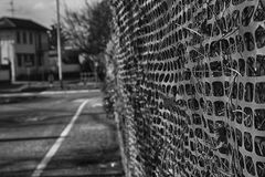 Construction site with safety orange fence, monochrome Royalty Free Stock Image