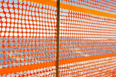 Construction site with safety orange. Construction site with safety plastic orange grid royalty free stock photos