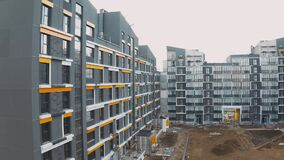 Construction site with scaffold, building work process modern an apartment panel house. Cladding and decoration of