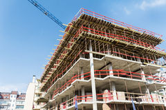 Construction site with scaffolding building and  tower crane Stock Photos