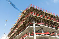 Construction site with scaffolding building and  tower crane Stock Photo
