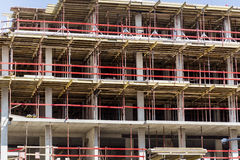 Construction site with scaffolding building and  tower crane Stock Photography