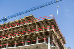 Construction site with scaffolding building and  tower crane Stock Images