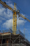 Construction site with scaffolding and a crane Royalty Free Stock Photography