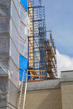 Construction site scaffolding repair structure renovation reconstruction. Construction scaffold plastic metal structure renovation building repair Royalty Free Stock Image
