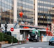 Construction site with Scania G410 cement mixer truck. STRASBOURG, FRANCE - MAR 5, 2018: Construction site with Scania G410 cement mixer truck at the royalty free stock images